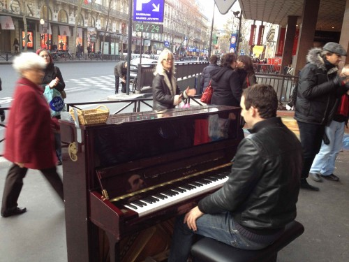 man playing piano on street paris december 2011