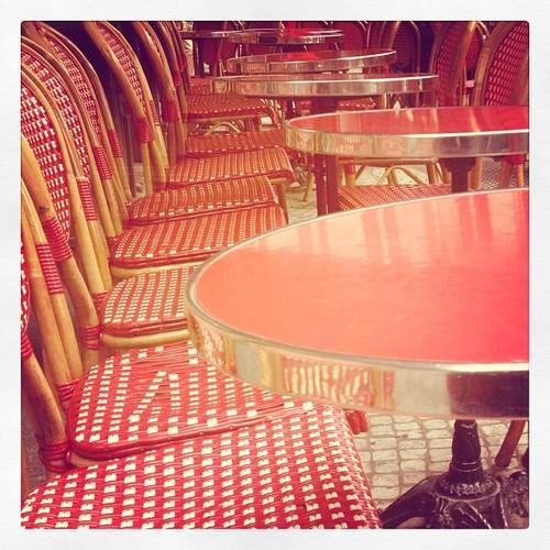 red chairs sidewalk paris