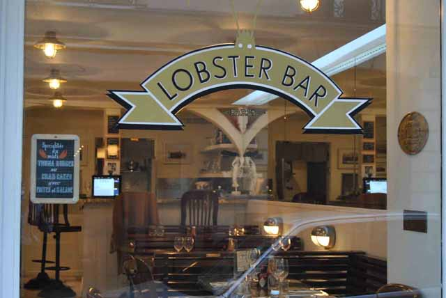 lobster bar paris outside glass sign
