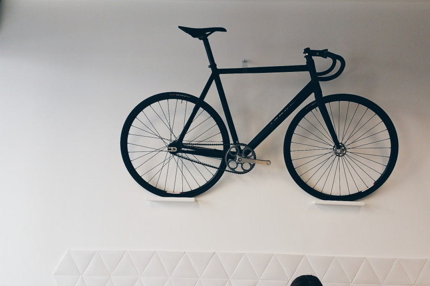 paris-bicycle-hanging-from-wall